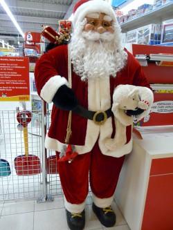 Santa begrüßt Weihnachtseinkäufer